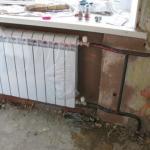 Замена радиатора отопления в гостиной
